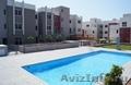 Просторные 2-х и 3-спальные апартаменты с большими верандами,  садом и бассейном