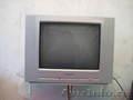 Идеальный телевизор для кухни или дачи